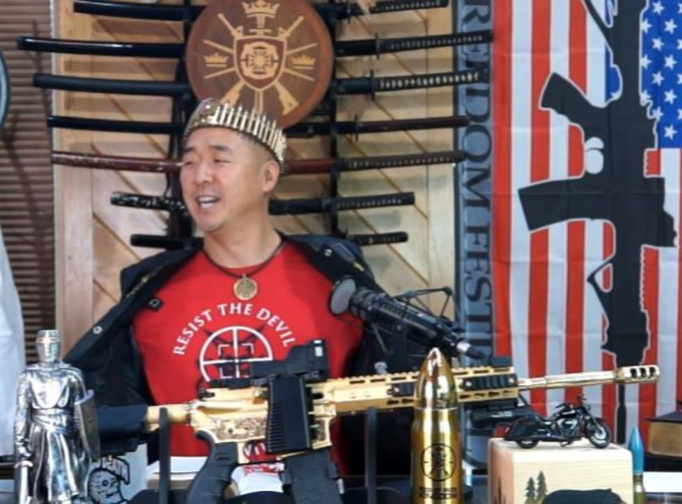 """<p>Hyung Jin """"Sean"""" Moon, the leader of Sanctuary Church and Rod of Iron Ministries, delivers his """"King's Report"""" sermon from behind  a golden AR-15</p>"""