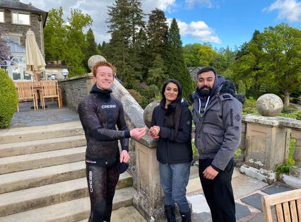 Newly-engaged couple Viki Patel and Rebecca Chaukria with Angus Hosking, the diver who retrieved their wedding ring after it went missing in Lake Windermere (Angus Hosking/PA).