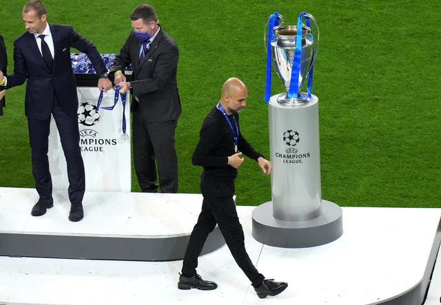 Pep Guardiola is forced to walk past the trophy