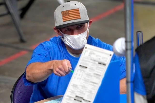 <p>A volunteer hand recounts votes in Maricopa County, Arizona </p>