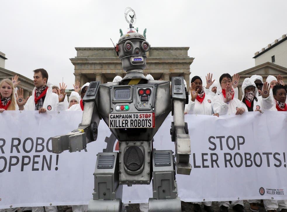 """<p>People take part in a demonstration as part of the campaign """"Stop Killer Robots"""" organised by German NGO """"Facing Finance"""" to ban what they call killer robots</p>"""