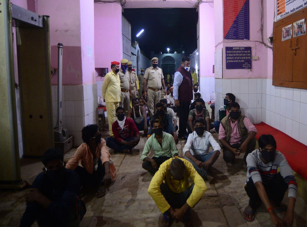 <p>Prisoners wait to be released on parole from Naini central jail in Allahabad</p>