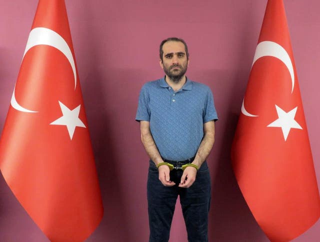 <p>Selahaddin Gulen, a nephew of US-based Muslim cleric Fethullah Gulen, stands between Turkish flags in a photo provided by the Turkish intelligence service</p>