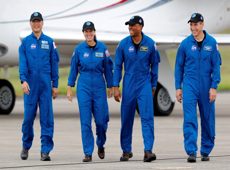 <p>File image: NASA astronauts Shannon Walker, Victor Glover, Mike Hopkins, and JAXA (Japan Aerospace Exploration Agency) astronaut Soichi Noguchi, who comprise Crew-1, walk at Kennedy Space Center ahead of the NASA/SpaceX launch of the first operational commercial crew mission in Cape Canaveral, Florida, US, 8 November, 2020</p>