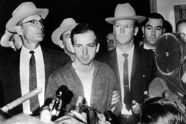 <p>Picture dated 22 November 1963 of US President John F Kennedy's murderer Lee Harvey Oswald during a press conference after his arrest</p>