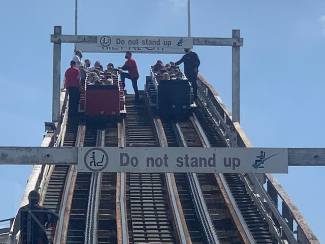 <p>Visitors had to be guided down from the Grand National rollercoaster ride at Blackpool Pleasure Beach, Lancashire, on Tuesday afternoon</p>