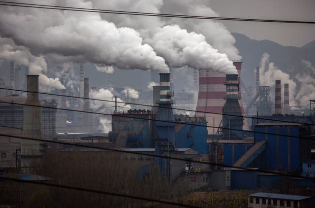 <p>Smoke billows from smokestacks and a coal fired generator at a steel factory in the industrial province of Hebei, China.</p>