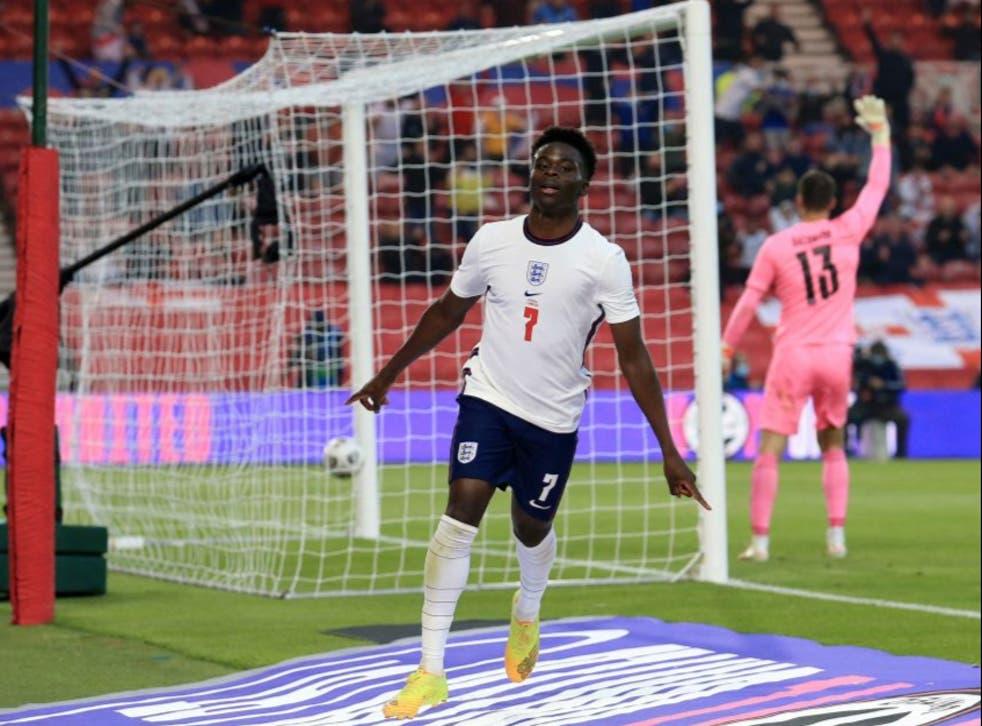 <p>Bukayo Saka celebrates scoring against Austria</p>