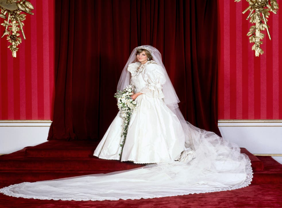 <p>The Princess of Wales in her bridal gown at Buckingham Palace after her marriage to Prince Charles at St. Paul's Cathedral</p>