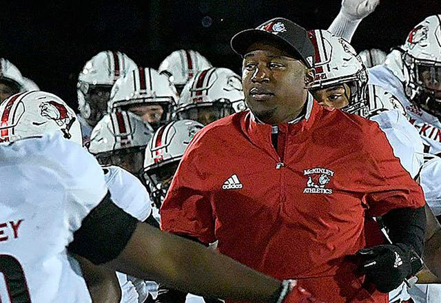 <p>Canton McKinley High School football coach Marcus Wattley. Wattley and seven assistant coaches have been suspended by the Canton City School District after one of the players said coaches forced him to eat pork in violation of his religious beliefs</p>