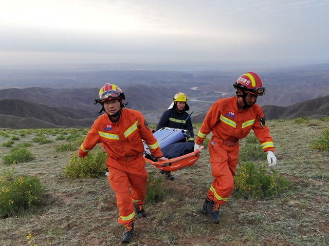 <p>File image: Rescue workers carry a stretcher as they work at the site where extreme cold weather killed participants of an 100-km ultramarathon race in Baiyin, Gansu province, China </p>