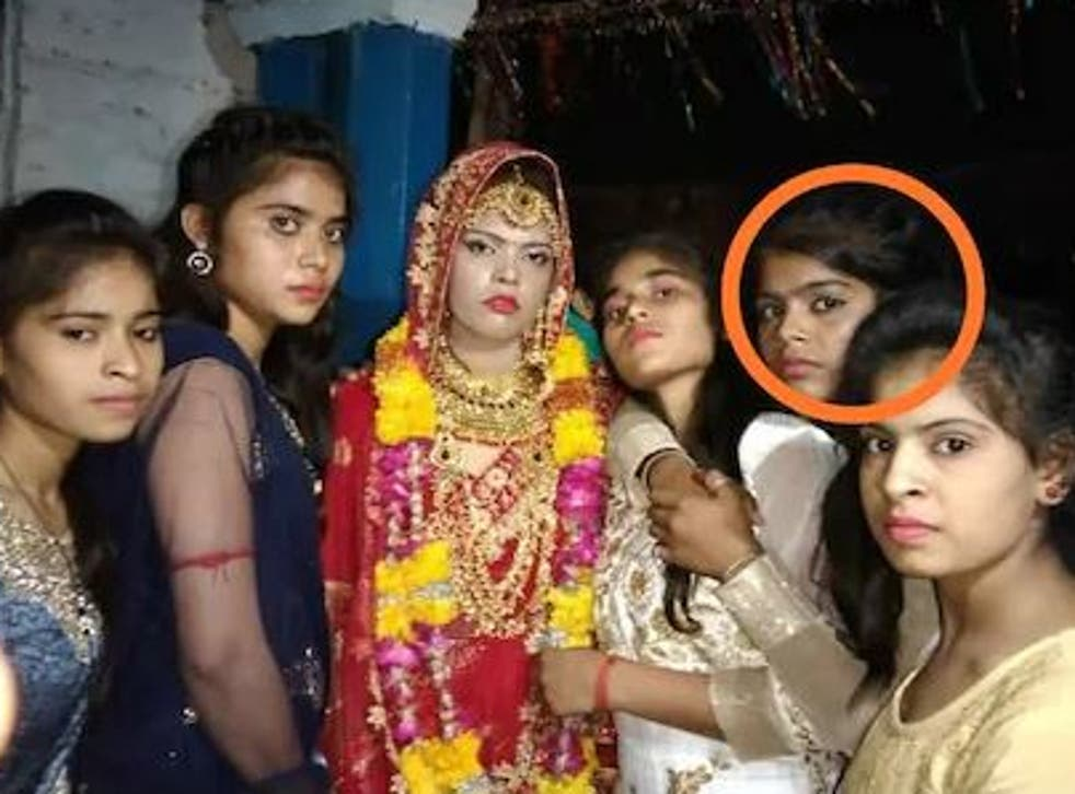 <p>The original bride (centre) alongside her younger sister (circled) who would go on to replace her at the ceremony</p>