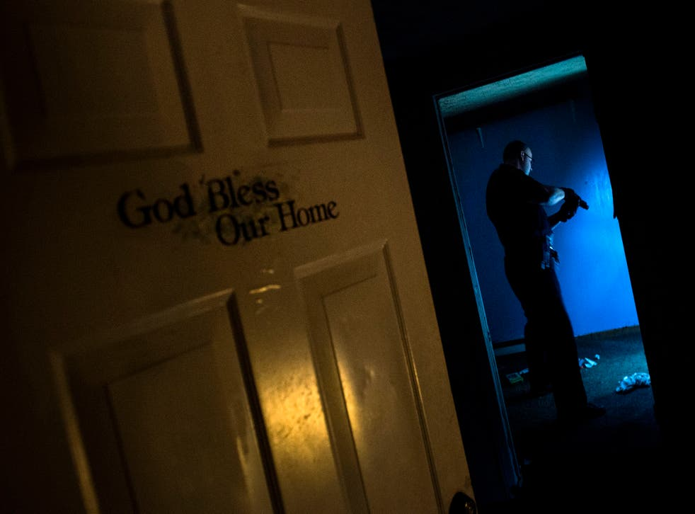 <p>Huntington Police searches an abandoned house littered with needles in Huntington, West Virginia</p>