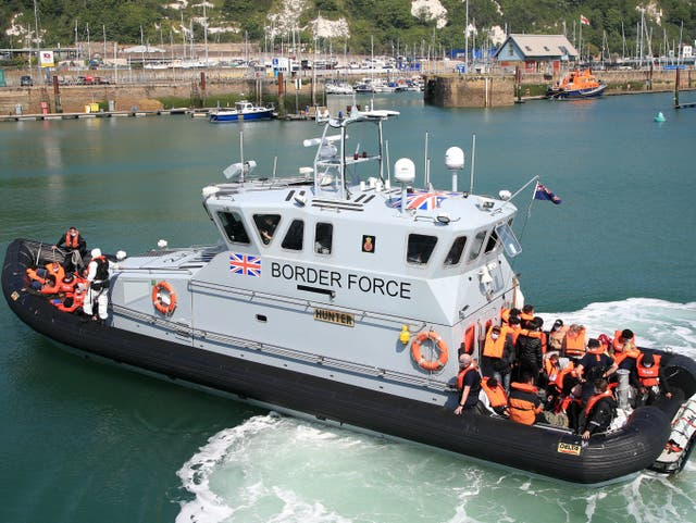 <p>A UK Border Force vessel returns to Dover after intercepting a small boat crossing in the Channel on Thursday</p>