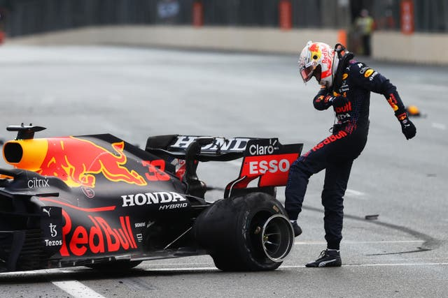 <p>Max Verstappen takes his frustration out on his blown rear-left tyre</p>