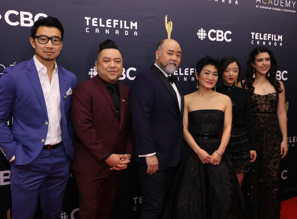 <p>Yoon (third from right) with the cast of Kim's Convenience</p>