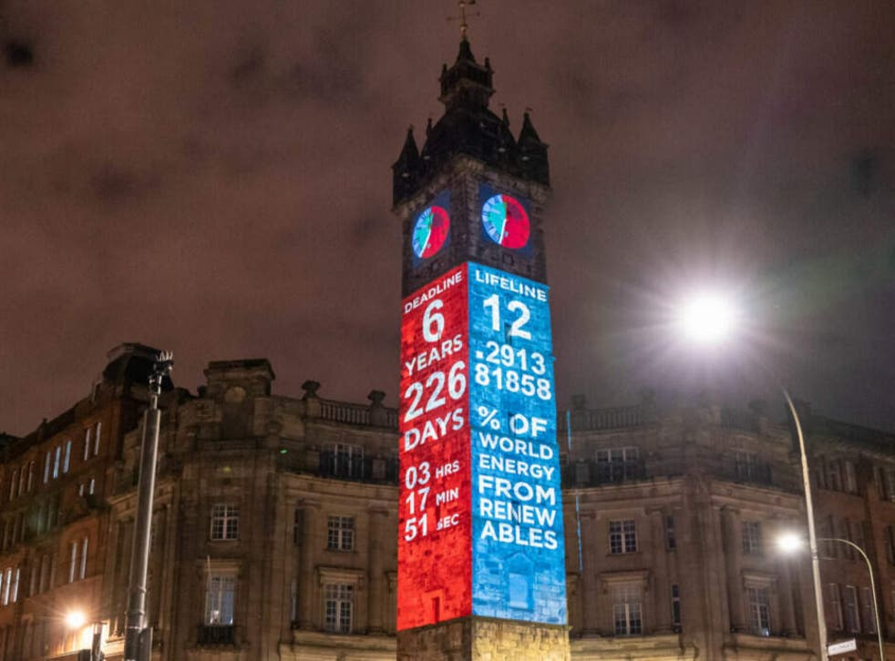 <p>The Climate Clock is projected onto Glasgow's Tolbooth Steeple</p>