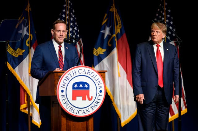 <p>Former U.S. President Donald Trump listens to Ted Budd announce he's running for the NC Senate at the NCGOP state convention on June 5, 2021 in Greenville, North Carolina</p>