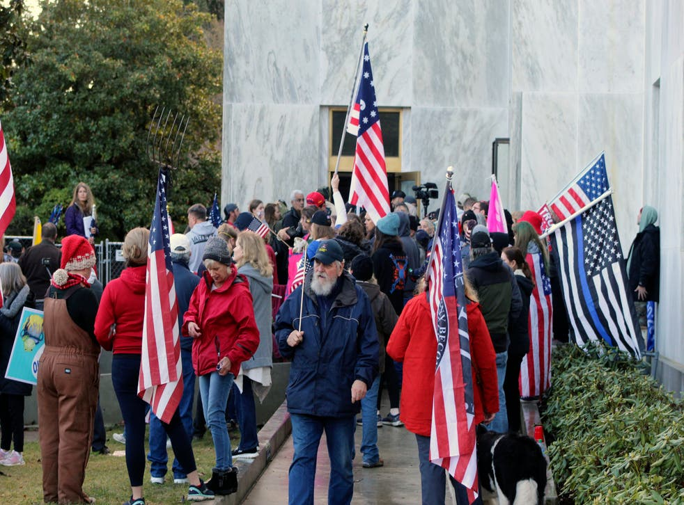 <p>Pro-Trump and anti-mask demonstrators hold a rally outside the Oregon State Capitol</p>