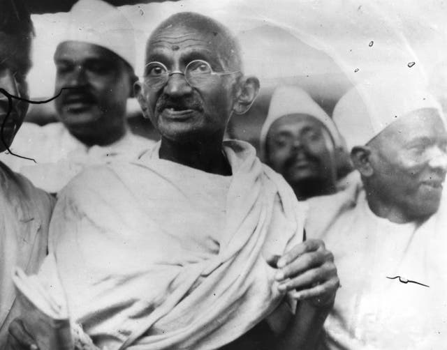 <p>File photo of Mahatma Gandhi (Mohandas Karamchand Gandhi, 1869 - 1948), Indian nationalist and spiritual leader, leading the Salt March in protest against the government monopoly on salt production</p>