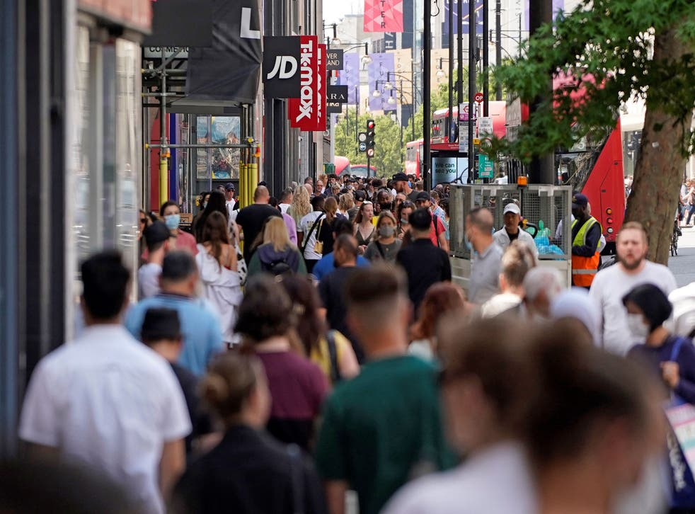 <p>Shoppers returning to high streets helped to boost economy in April</p>