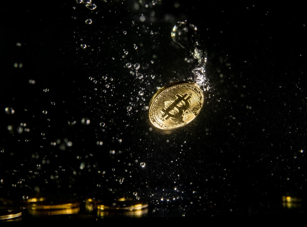 <p>A visual representation of the digital currency Bitcoin sinking into water on 15 August, 2018 in London, England</p>