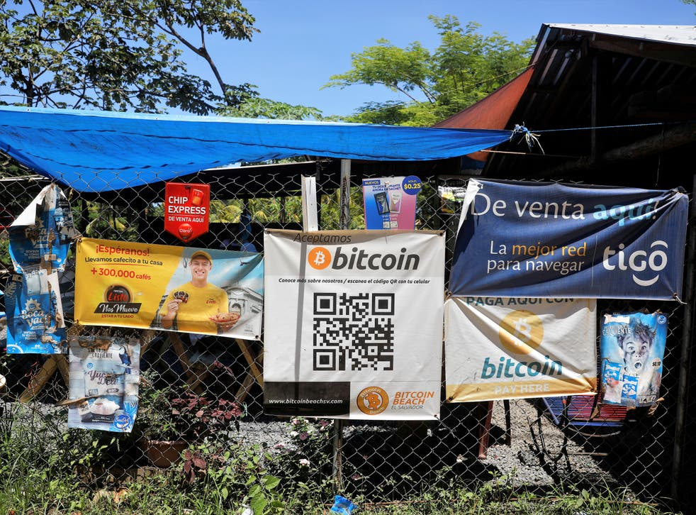 <p>Bitcoin banners are seen outside of a small restaurant at El Zonte Beach in Chiltiupan, El Salvador 8 June, 2021</p>