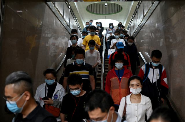 <p>Ground down by the sapping realties of modern city life, China's youth are 'lying flat,' the latest buzzword for those tapping out of a culture of endless work with little reward</p>