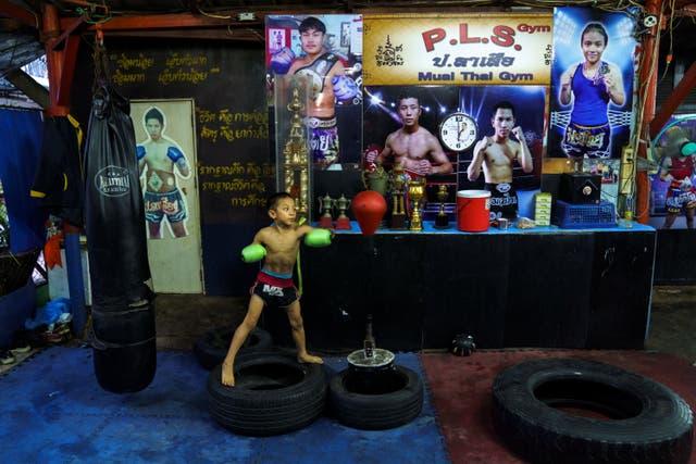 <p>Pornpattara Peachurai, known as Tata Por Lasua in the ring, trains at a gym in Bangkok</p>