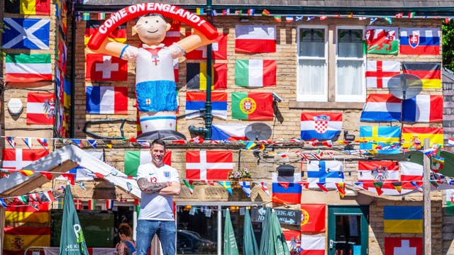 Adam Chamberlain, 45, general manager of Big Tree pub in Sheffield, has put up over 500 flags, taking 36 hours, in preparation for Euro 2020, which kicks off this weekend