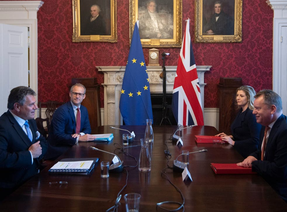 <p>David Frost, right, speaks to his EU counterpart Maros Sefcovic earlier this month. There have been many, many discussions over Brexit during the last five years</p>