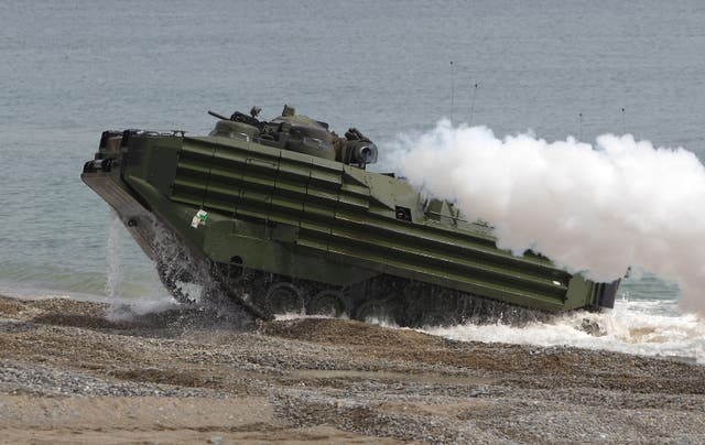 <p>U.S. Marine's Amphibious Assault Vehicle (AAV) from 3rd Marine Expeditionary Force landing team deployed from Okinawa, Japan, move their position during the U.S. and South Korean Marines joint landing operation at Pohang seashore on April 26, 2013 in Pohang, South Korea</p>