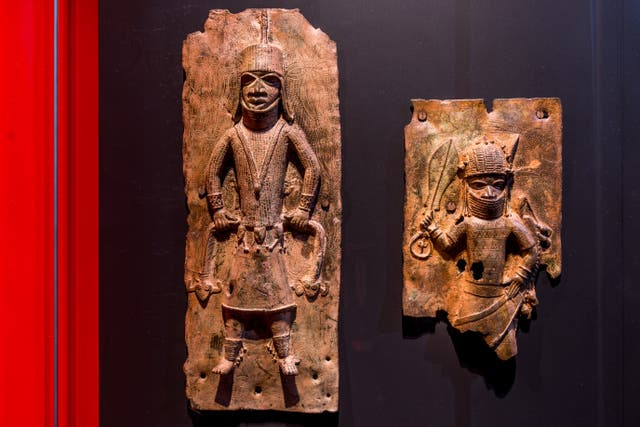 <p>Sculptures looted by British soldiers from the Kingdom of Benin in 1897 hangs on display in the 'Where Is Africa' exhibition at the Linden Museum on May 05, 2021 in Stuttgart, Germany</p>
