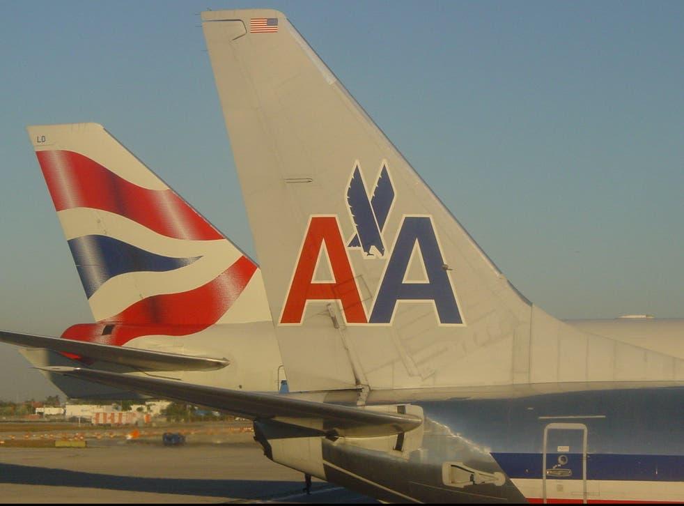 <p>Cross purposes: British Airways and American Airlines aircraft at Miami airport in Florida before the coronavirus pandemic </p>
