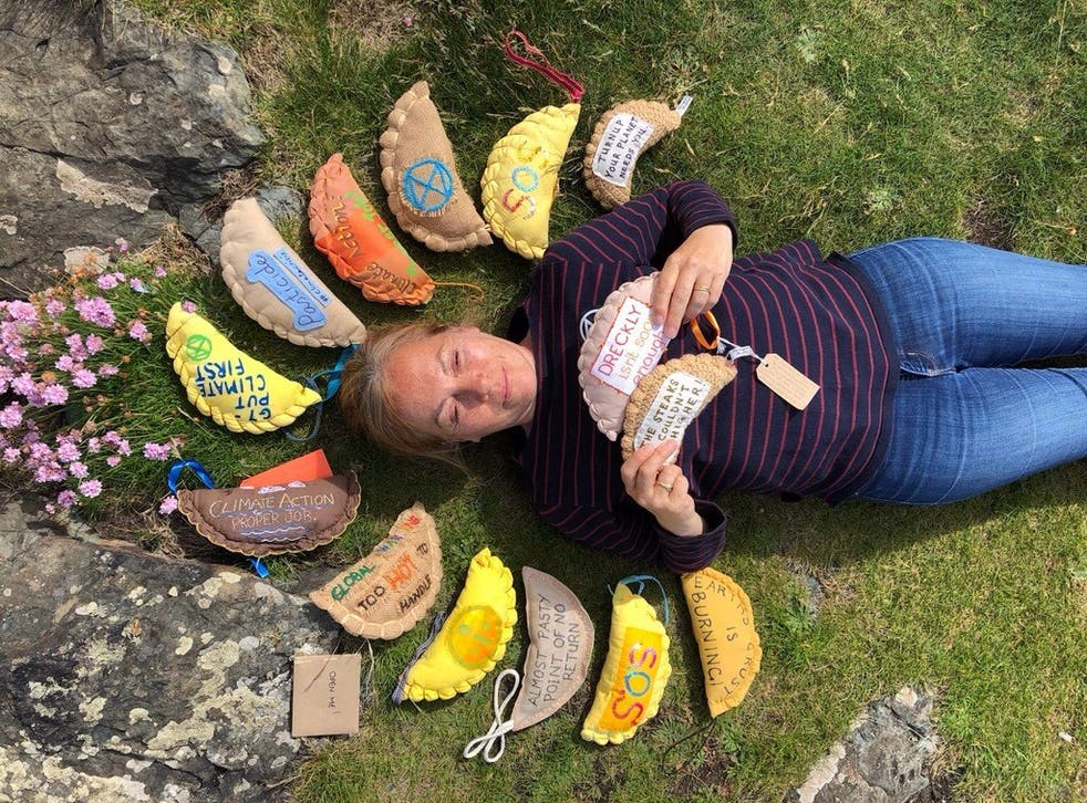 <p>Extinction Rebellion supporter Sarah White surrounded by knitted pasties</p>