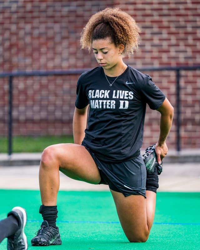 England Under-21 hockey player Darcy Bourne takes the knee wearing a Black Lives Matter T-shirt