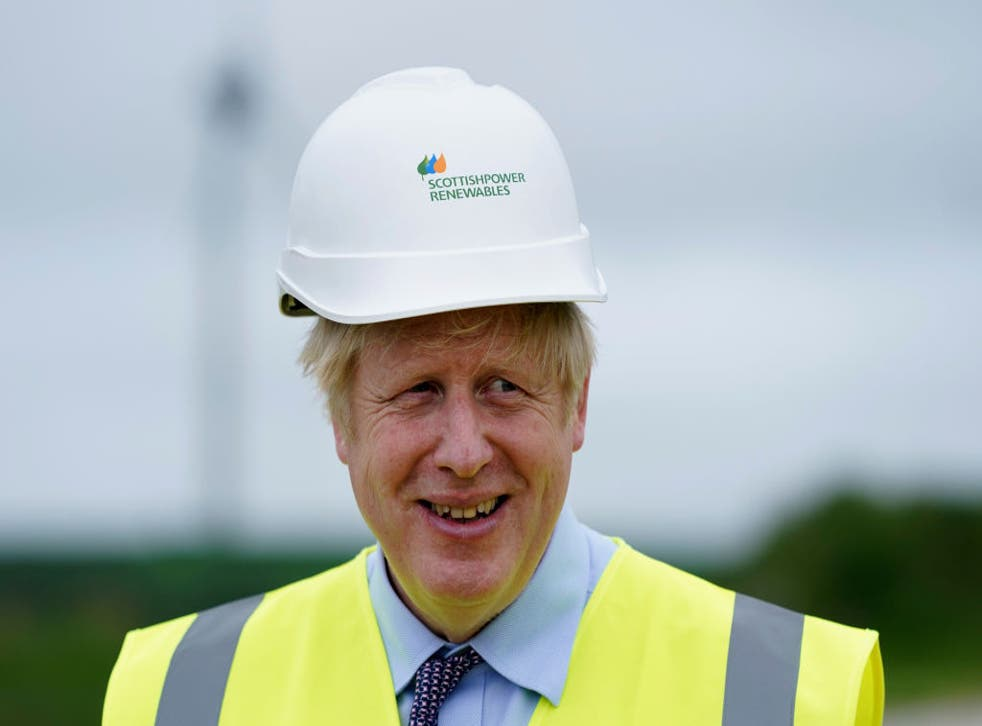<p>Boris Johnson visits the Scottish Power Carland Cross Windfarm on 9 June</p>