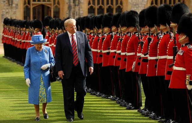 <p>The Queen inspects a guard of honour with Donald Trump in 2018</p>