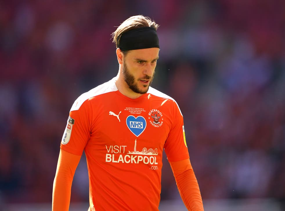 <p>Luke Garbutt played a key role for Blackpool during their promotion-winning season</p>