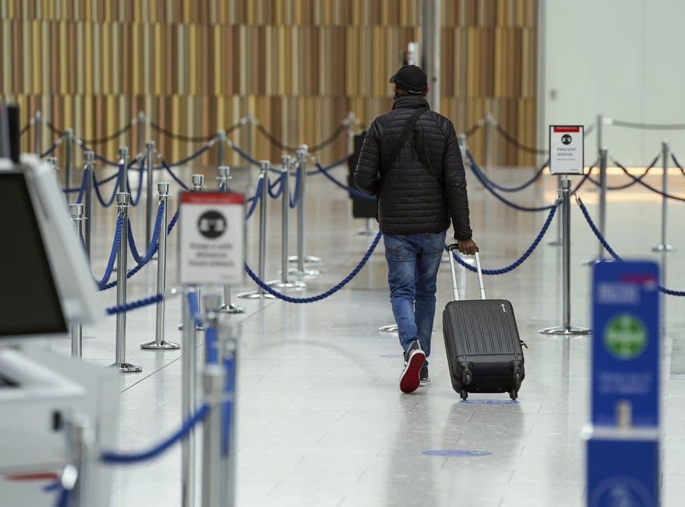 <p>A passenger at Heathrow</p>