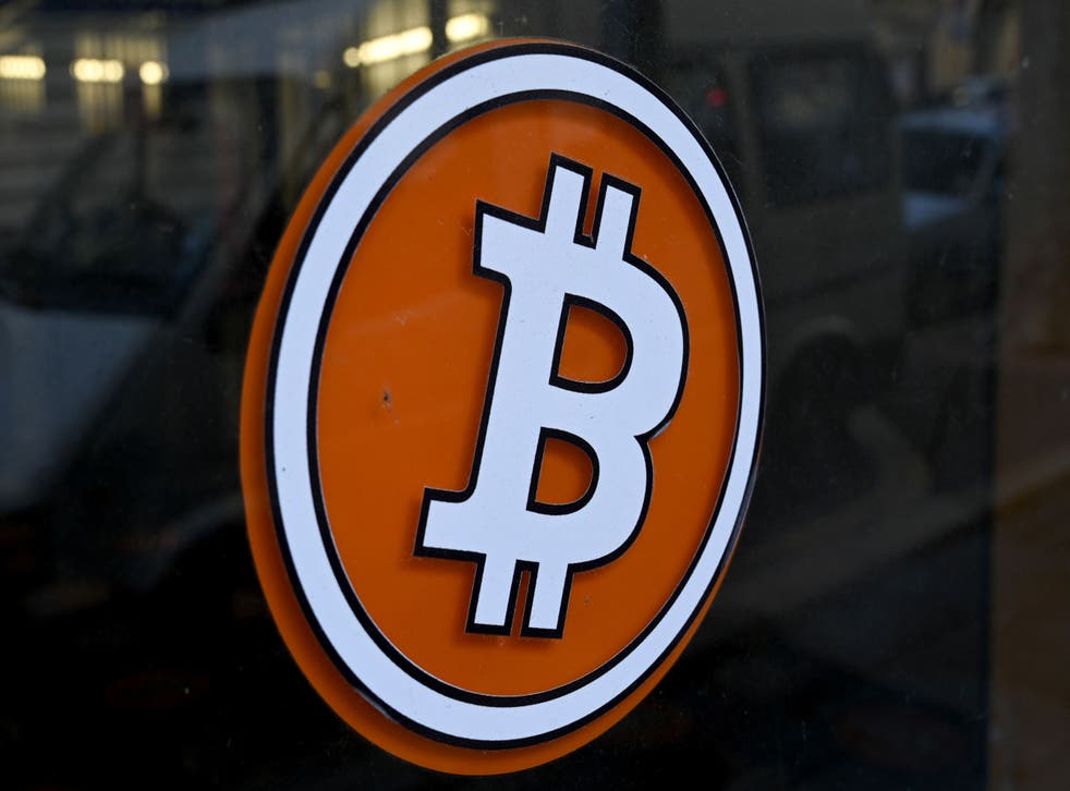 <p>The logo of Bitcoin digital currency is pictured on the front door of an ATM in Marseille, southern France</p>