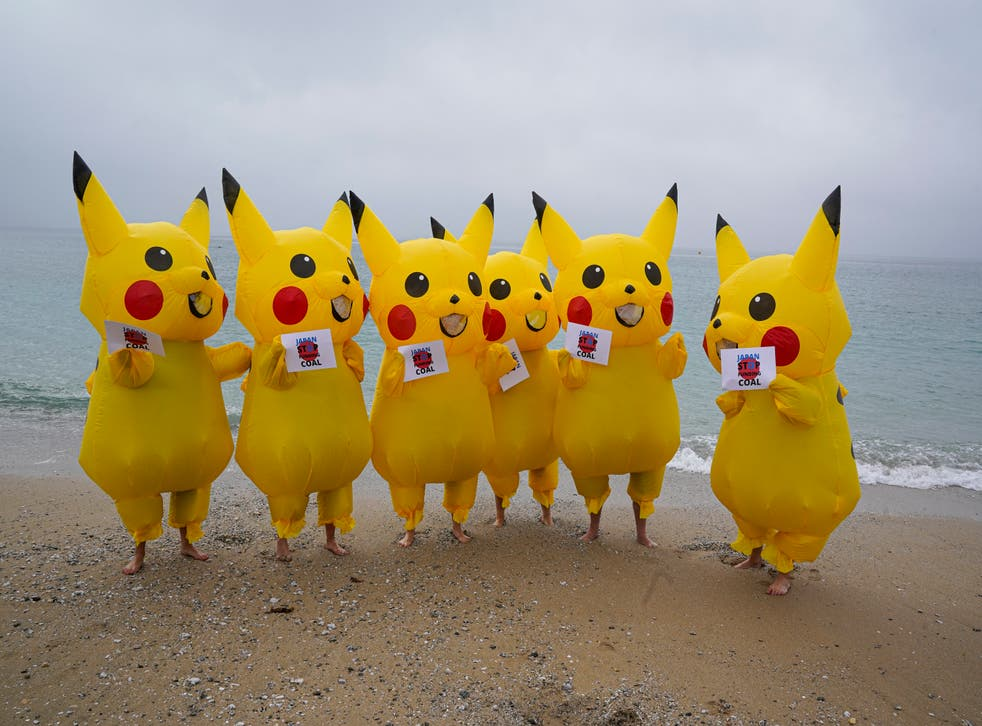 <p>Protesters dressed as Pikachus object to Japan's coal policy on a beach in Cornwall</p>