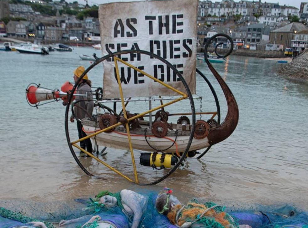 <p>Ocean Rebellion protesters hold a demonstration in St Ives, Cornwall, on Friday, 11 June, to call on G7 leaders to take action to protect the world's oceans.</p>