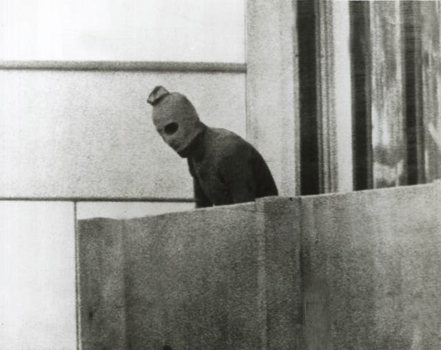<p>Defining moment: a hooded Palestinian on the balcony above the Israeli athletes </p>