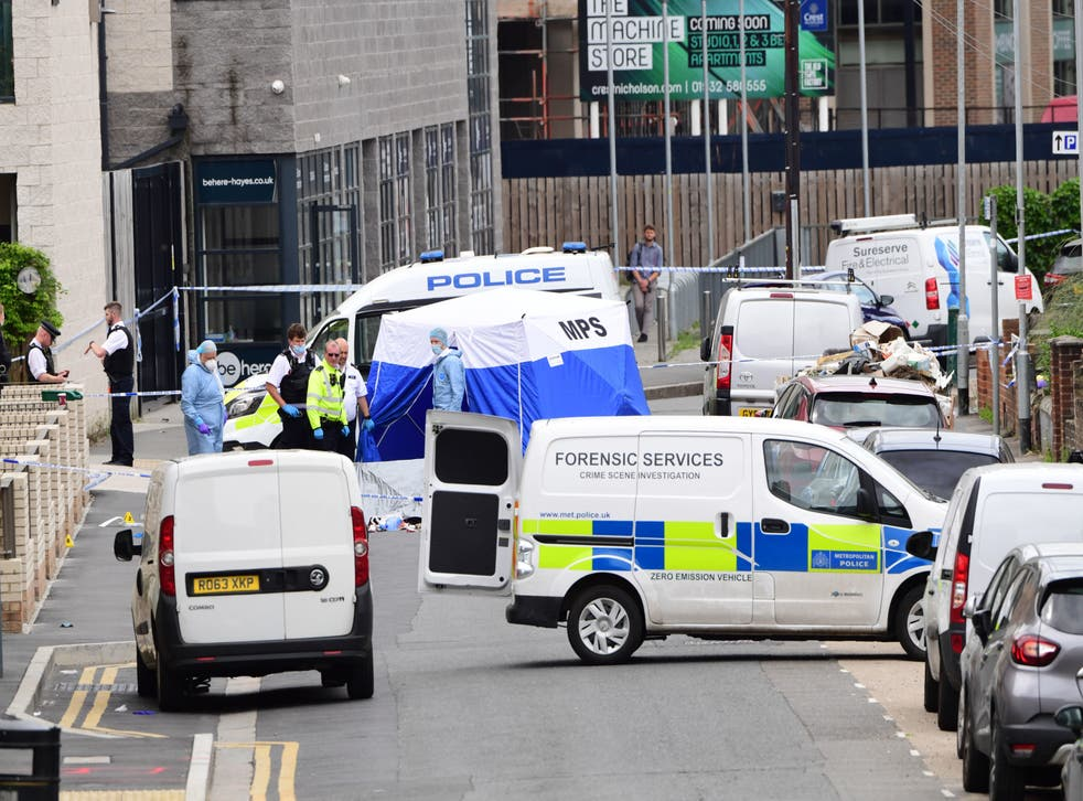 <p>Forensic officers join police on the scene of the stabbing in Hayes</p>