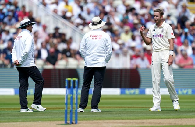 England's Stuart Broad (right) speaks to the umpires