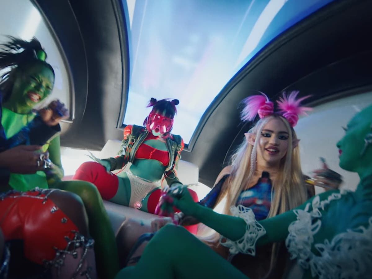 Doja Cat and Grimes have an intergalactic night out in Need to Know video - The Independent