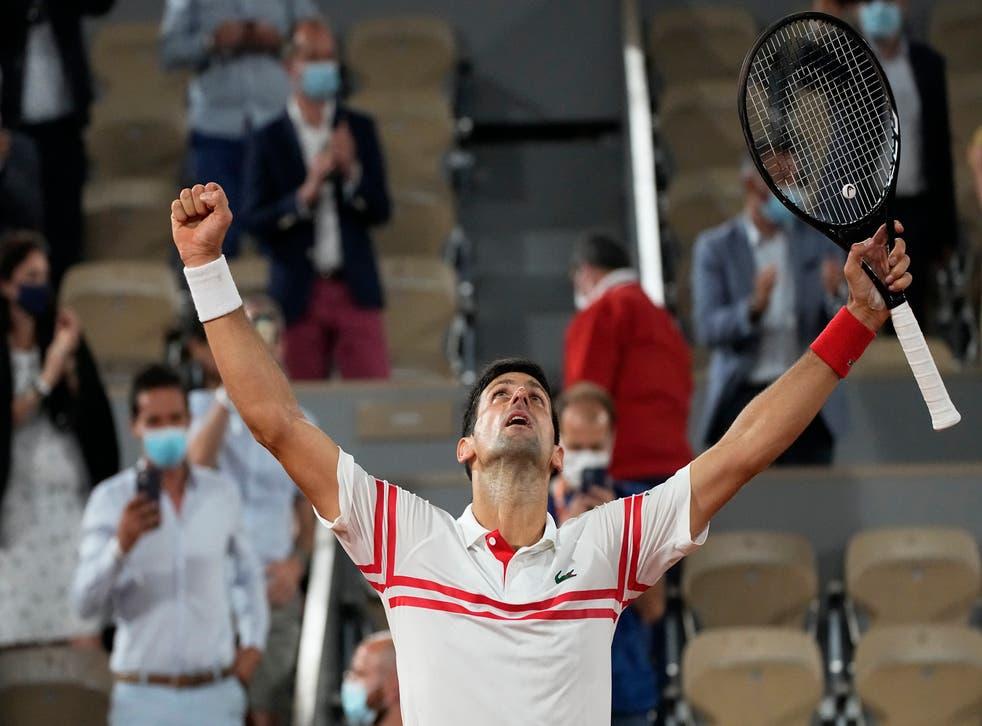 <p>Novak Djokovic celebrates after ending the reign of Rafael Nadal</p>