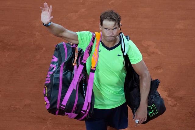 Rafael Nadal waves as he leaves Roland Garros