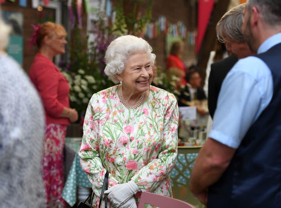 <p>Queen Elizabeth II smiles as she meets people from communities across Cornwall</p>